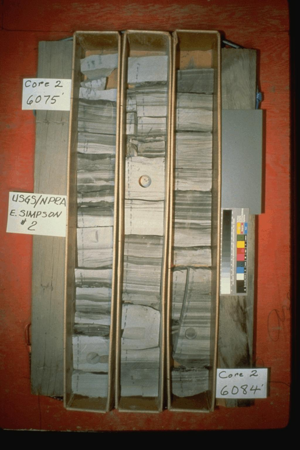 A box containing 9 feet of 4-inch diameter core from the National Petroleum Reserve, Alaska, showing the fine-scale structure and composition of the rock layers being drilled.