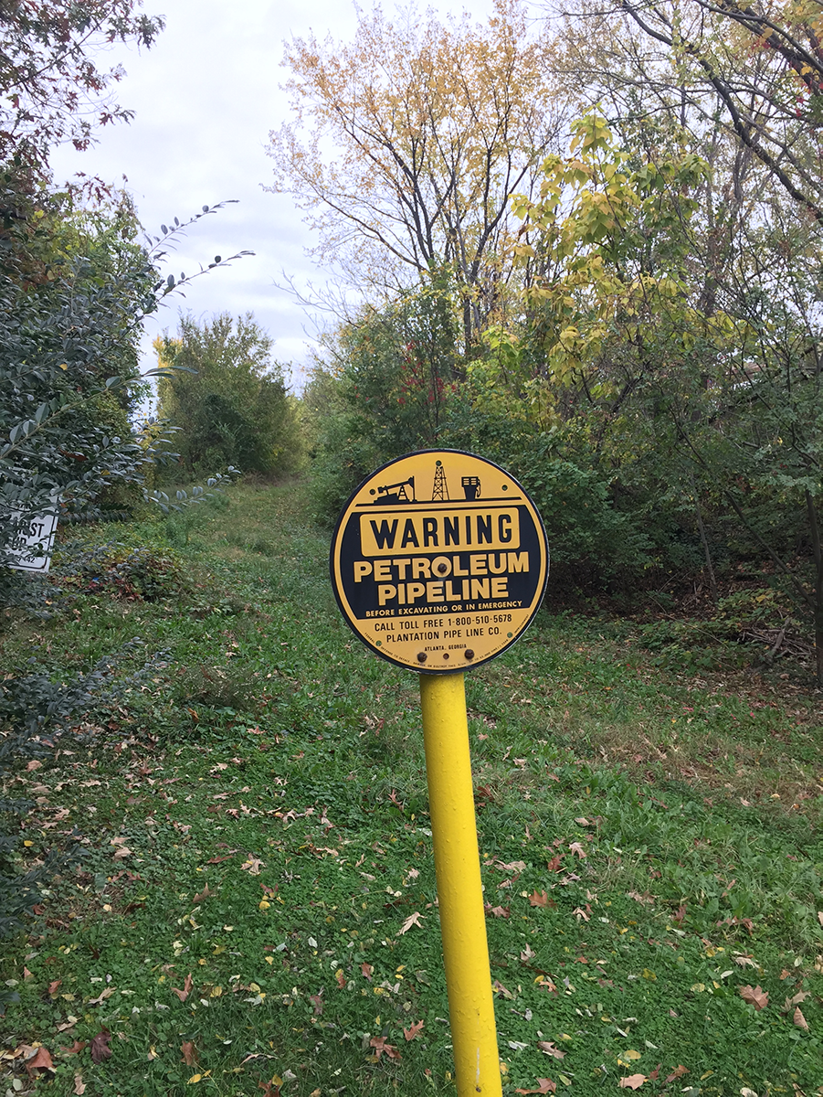 Sign indicating a buried refined-product pipeline in Alexandria, Virginia.