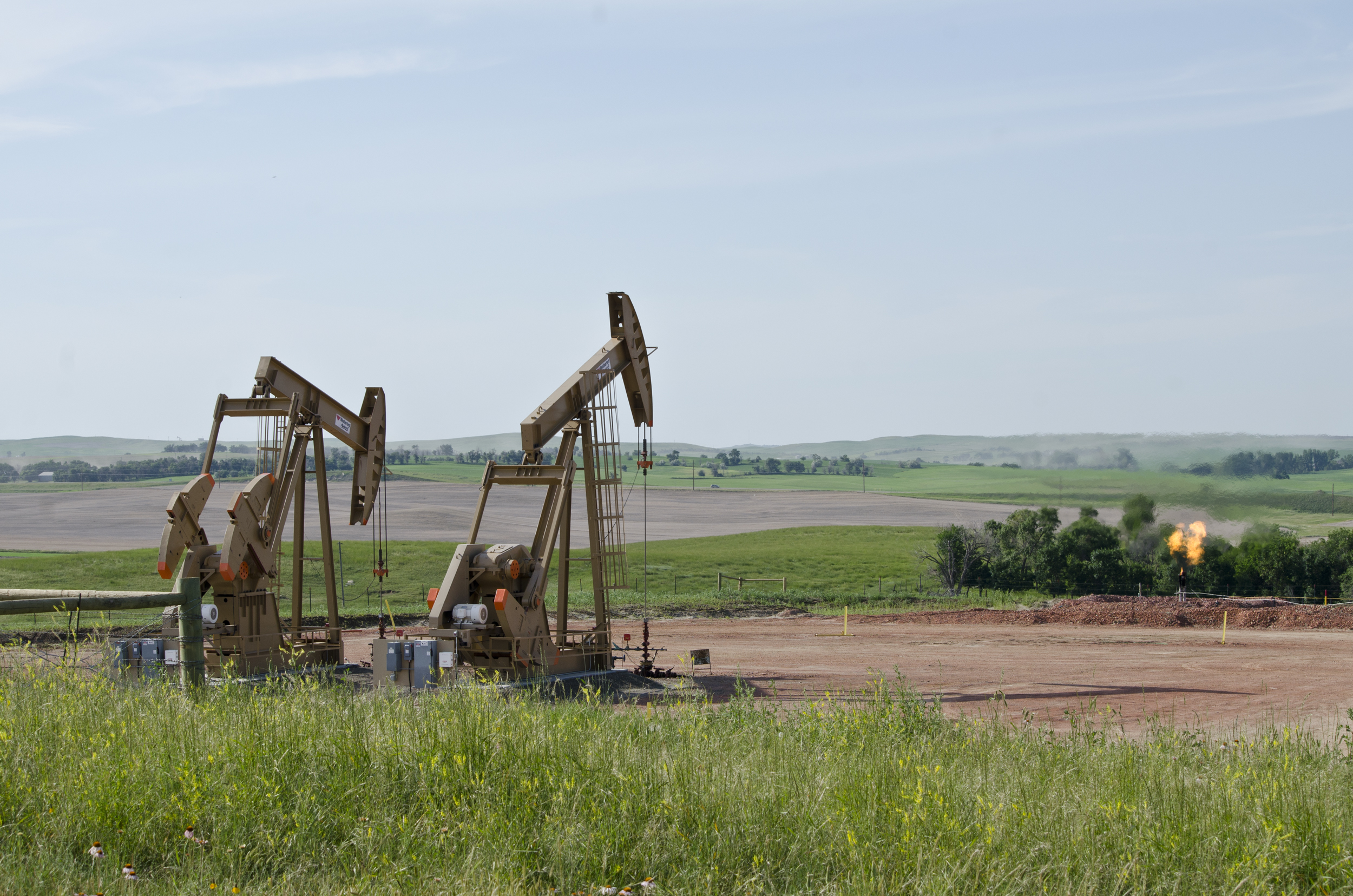 Flaring of unprocessed natural gas, as seen here on a well site in North Dakota (flare on right of picture), is one of several oilfield processes that can negatively affect air quality, as well as increasing carbon dioxide emissions.