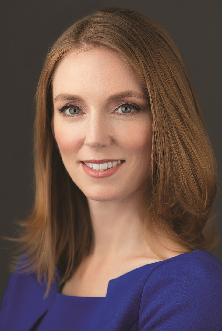 Allyson K. Anderson Book. Woman smiling in purple dress.