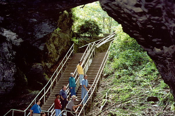 Fig 1. A NPS ranger leads visitors into the mouth of Mammoth Cave National Park, Kentucky.