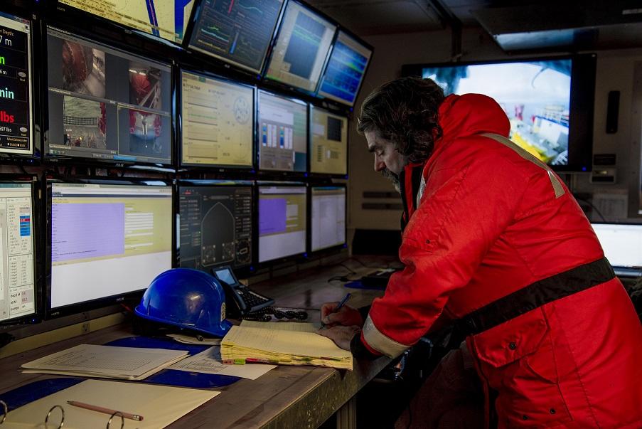 Oregon State University Professor Miguel Goñi monitors the deployment of a multi-core during a cruise in the Chukchi Sea aboard the R/V Sikuliaq.