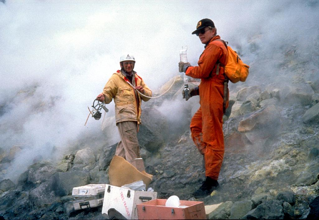 Two volcanologists working on Mt. St. Helens in protective gear