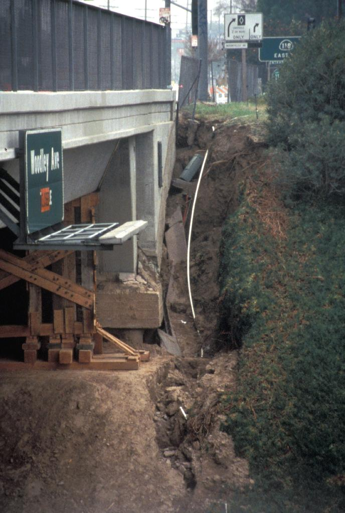 Burst water mains flooded portions of the 118 Freeway and severely eroded the footings of the Balboa Blvd. overpass during the 1994 Northridge Earthquake. Photo by P.W. Weigand. (Copyright California State University Northridge Geology Department)