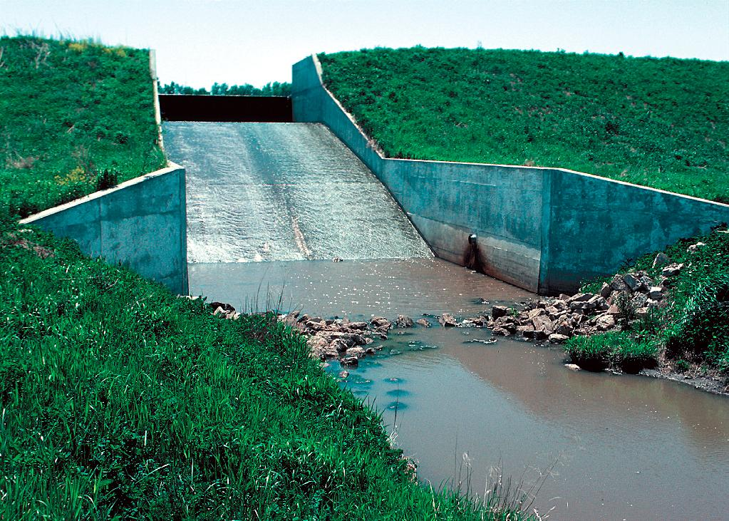 Concrete chute spillway in a dam built as part of a watershed project for flood and erosion control.