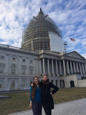 Spring 2015 Intern Piper Lewis (left) and Fall 2014 intern Peri Sasnett (right) in front of the U.S. Capitol Building