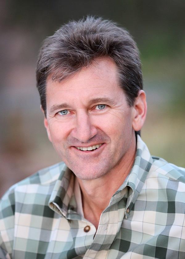 Scott Tinker. Man in plaid shirt smiling.