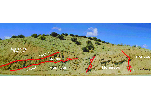 Fig. 4. This road cut shows the Ranchos fault zone west of Placitas, where older Mesozoic strata (Mancos and Morrison formations) are faulted against younger Santa Fe Group basin fill. Credit: L. Price
