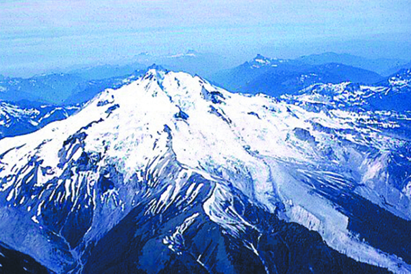Fig. 1. Although Glacier Peak normally can not be seen from any urban areas, this active volcano periodically erupts in an explosive catastrophic manner that could affect the lower part of the populated Skagit River Valley. Credit: D. Mullineaux, USGS