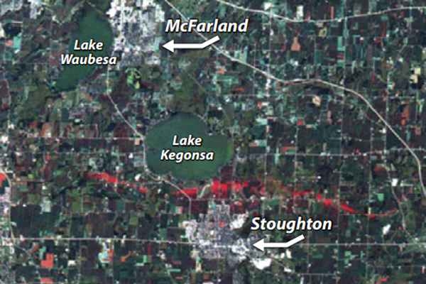 Fig. 3 Image shows the ground trace of the tornado. It uses the blue and green spectral bands of a Landsat 5 TM image acquired one month before the storm and the red band of a Terra ASTER image acquired 10 days after the storm.