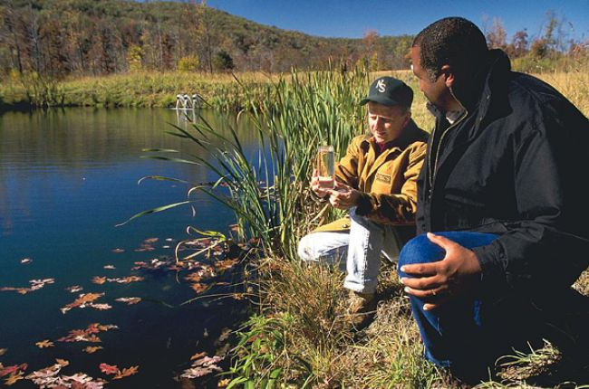 Survey of water quality in a mine water filtration pond. Image Credit: Ron Nichols, USDA NRCS