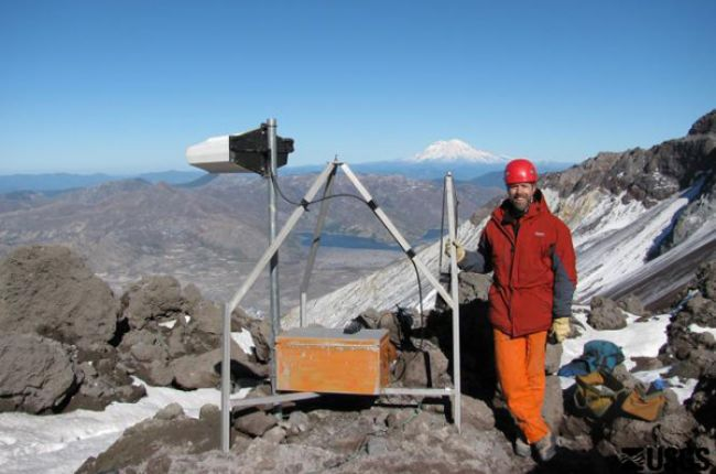 A U.S. Geological Survey seismologist installs a monitoring station on Mt. Rainier. Image Credit: U.S. Geological Survey