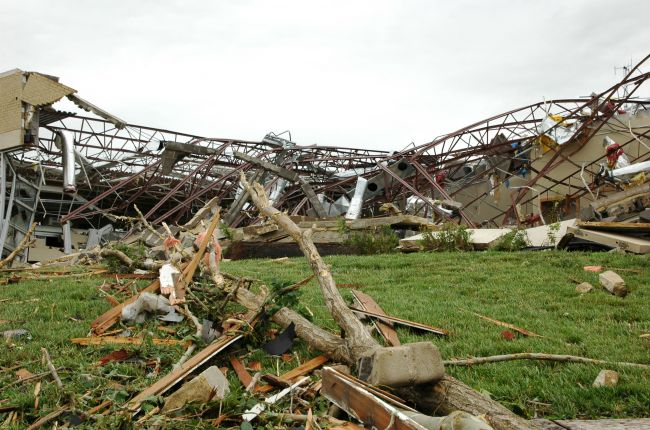 A middle school is left in a mangled heap after a June 11 F-3 tornado ripped through Chapman, Kansas. Image Credit: Photo by Anita Westervelt/FEMA