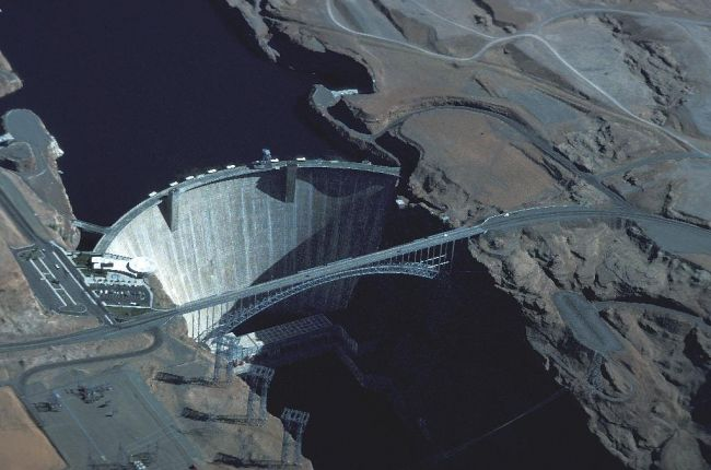 The Glen Canyon Dam on the Colorado River is one of the largest concrete dams in the world and impounds Lake Powell which provides water for a large area of the arid Southwest.