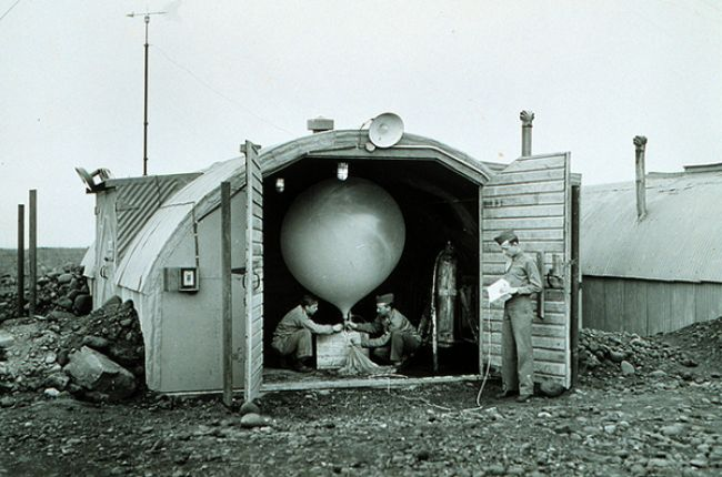 Army Air Force meteorologists prepare to launch hydrogen-filled balloon Balloon transported radiosonde that transmitted back to station Radiosonde measured temperature, humidity, and pressure. Iceland, Meeks Field. 1944 ca.