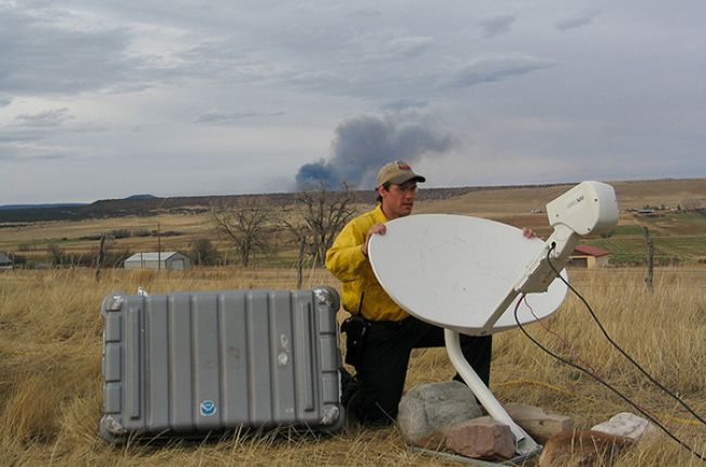 National Weather Service IMET Brent Wachter aiming/positioning the Direcway satellite dish.