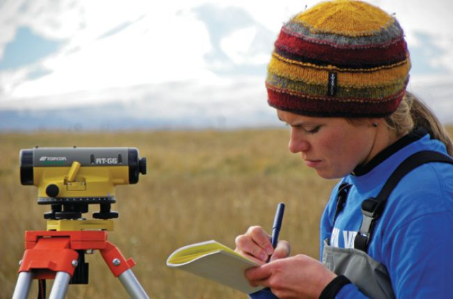 Geoscientist taking notes in the field. Photo courtesy of Rob Thomas, from AGI's 2014 Life in the Field contest.