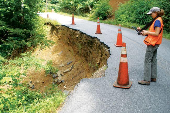 Surveying a debris slide. Credit: Appalachian Landslide Consultants, PLLC/photo by Stephen Fuemmeler