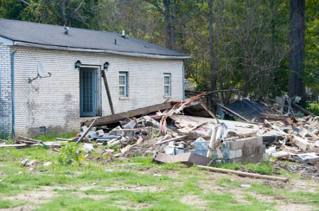 The aftermath of flooding is seen at a home that was damaged when flooded creeks swept water through Flat Top, Kentucky. Photo by Patsy Lynch/FEMA