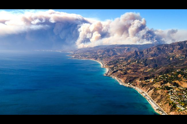 Smoke billowing offshore from the Woolsey fire, California coast. Image Credit: U.S. Forest Service