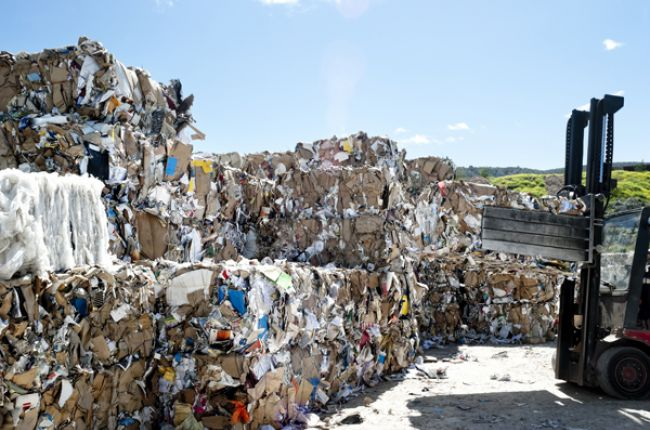 Pile of papers in a recycle center. Image Credit:  Antlio/Shutterstock.com