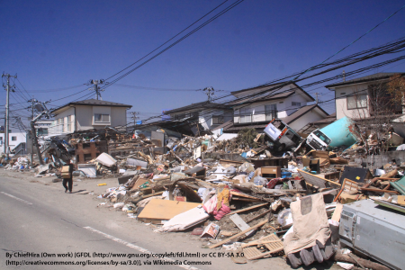 The residential quarter was mountain of debris in Tagajo, Miyagi was heavily damaged in the 2011 Japanese tsunami. Cars and an oil tank carried from port to Tagajo.