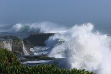 Large storm waves crashing on the rocks near Santa Cruz, California