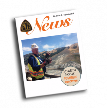 September 2016 AEG News Cover. Man in safety gear looking over pit mine.