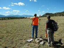 Kirby Bean, BLM Certified Mineral Examiner showing Sarah Hill the boundaries of a mining claim
