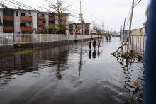 Puerto Rican residents walk in flooded streets in Condado, San Juan, Puerto Rico.