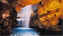 A waterfall in the interior of Smoo Cave.
