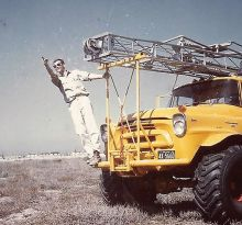 Meckel leaning out of a truck working on Shell's clastics project, 1965