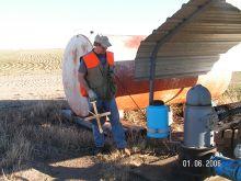 Rex Buchanan examines a water well in Kansas