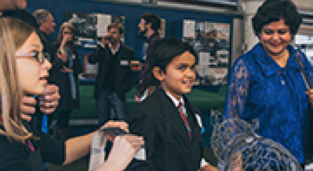 A child receives an award at an AGI event
