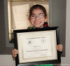 Amery Green holds up her Honorary Junior Paleontologist Certificate