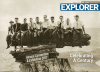March Cover of Explorer from AAPG. Historical black and white photo of men sitting on rocks.